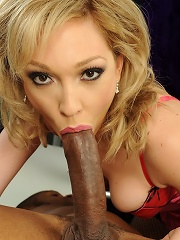 Skinny blonde babe Lily riding on a black cock